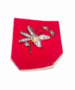 Brosa aurie cu cristale magice reprezentand un fluture